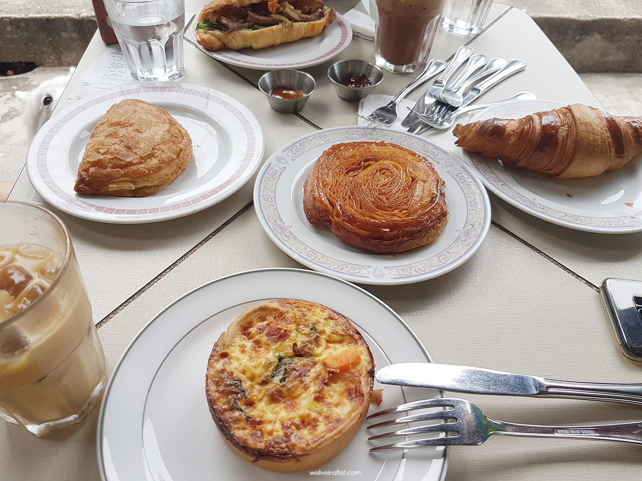 dog-friendly cafe - Tiong Bahru Bakery table spread - bread and other baked goods
